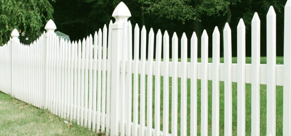 Classic white picket fence made out of plastic Canada
