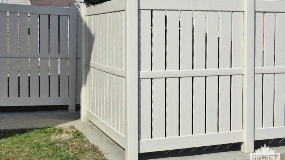 Grey semi-privacy slat vinyl fence