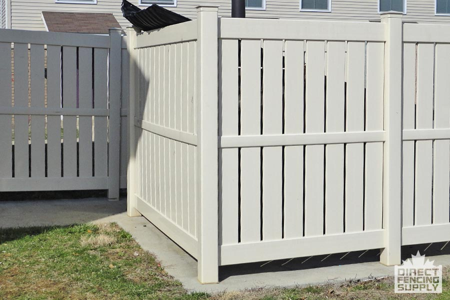 Grey semi-privacy slat vinyl fence