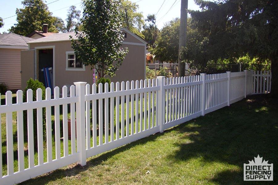 Vinyl picket fence with bottom rail