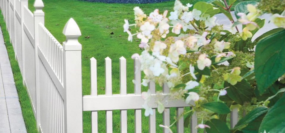 White picket fence with Gothic caps in Montreal