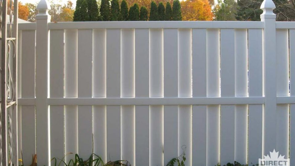White PVC fencing with shadow slats