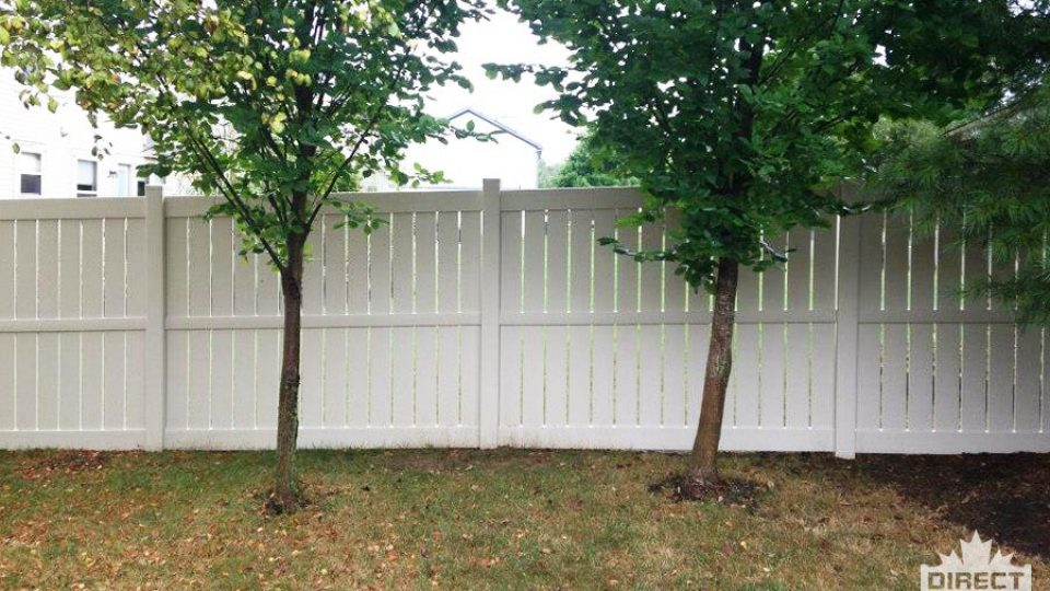 White vinyl fencing with vertical boards